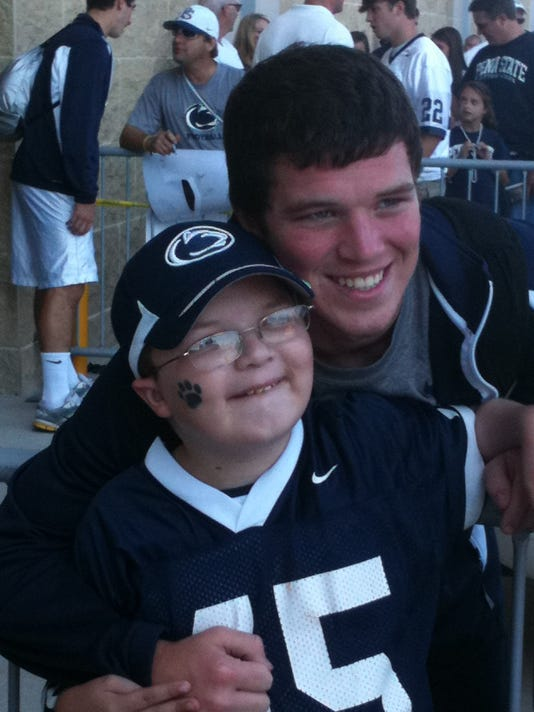 The inspiration behind Penn State  punter Alex Butterworth (right) is his younger brother, Kyle.