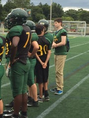 Trevor Sullivan (far right) stands on the sidelines with his Groves High School freshman football teammates.