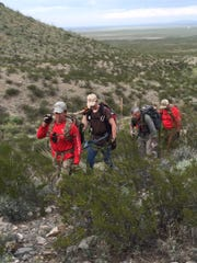 Mesilla Valley Search and Rescue members hike up the northeast end of the Franklin Mountains in El Paso in mid-October. From left to right, Ned Tutor, Bryndan Gardner, Al Berryman and Vic Villalobos.
