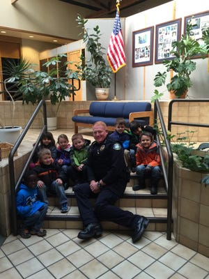 Chief Darren Hooker takes time out to welcome a squad of visitors from River Raccoons pre-school.