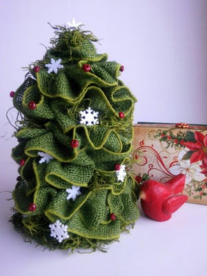 A miniature Christmas tree is made from green burlap wire ribbon and a foam cone.
