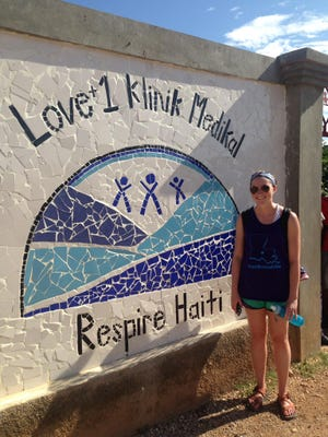 Caitlyn Olivier in front of the newly constructed Medical Clinic at Respire Haiti.