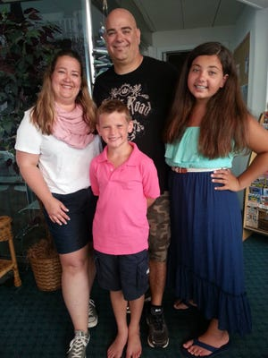 The D'Amico family - mother Laura, dad Chris, daughter Vianna and Christopher, 10, before Christopher died in a boating accident on Lake Hopatcong on June 24.