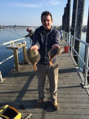 The author Dan Radel, with a pair of winter flounder caught Saturday in Shark River.