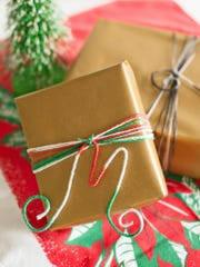Create a unique gift topper by bending 8-gauge wire into the shape of a letter, then wrap it with yarn or ribbon and glue to adhere. Attach the monogram with matching yarn or ribbon to the package.