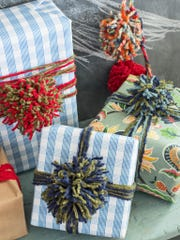 Colorful yarn pom-poms adorn gift packages.