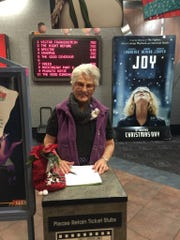 "Alexa ""Sue"" Hooser greets guests during a special screening"