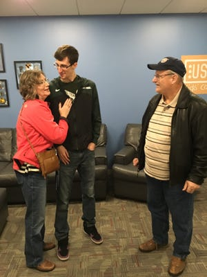 Heather Lane-Fowler and Jack Fowler surprise Trent Fowler at the USO office in the Boston airport.