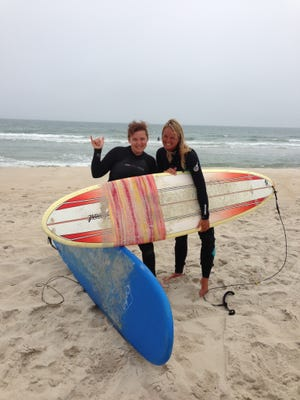 Jennifer Cox, left, is shown with local surf instructor Michelle Sommers in this file photo.