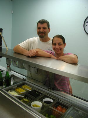 Darin Vanciel and wife Kimberly Buttler are the owner-staff of Fat Darin's Subs to Go, a newly-opened sandwich shop.