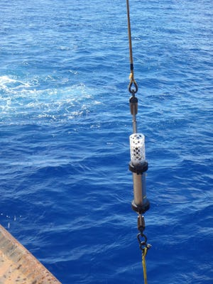 Photo of Deep-ocean hydrophone being brought back onboard USCG Cutter Sequoia.