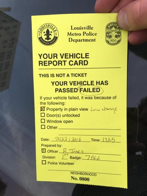 """Police are leaving more """"Vehicle Report Cards"""" on cars downtown."""