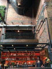 Soaring ceilings dominate Old Glory, a new bar in the