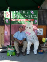 Houston Dorris poses with the Easter bunny during last year's chick day festivities.