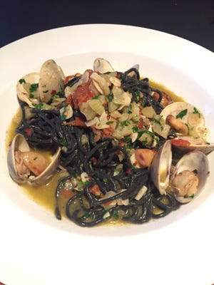 Black spaghetti with clams is just one of the authentic Italian dishes on the menu at Gola Osteria.