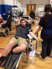 Joey Hubbard donates blood during the Delmar High School SGA blood drive.