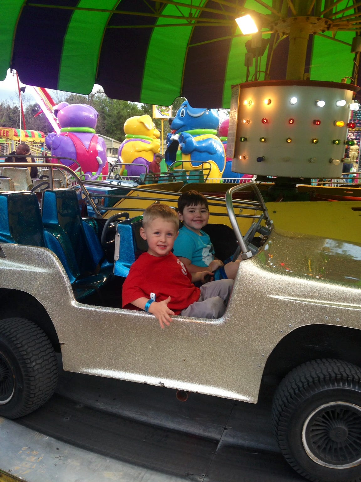 "Dylan rides the cars at the Scott Boudin Festival with Keegan Lavergne, who was the ""Boudin King"" of the event in 2014."