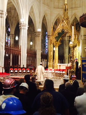 Sixteen hard hats symbolizing the 16 construction workers who were killed on the job in New York City over the last year, including Luis Mata of Port Chester, were displayed in front of the altar in St. Patrick's Cathedral during a Workers Memorial Day Mass, April 28, 2016.