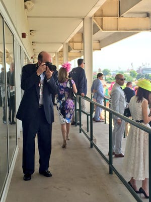 Neil Budde capturing the action on Millionaires Row at Churchill Downs on Kentucky Derby Day.