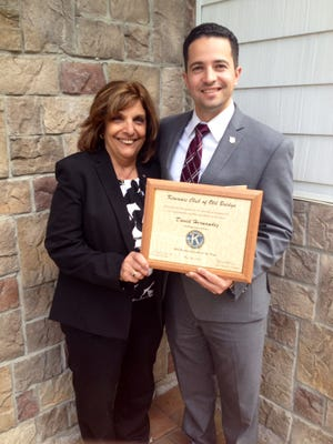 Kiwanis Club of Old Bridge President Mary Spina presenting the 2016 Business Leader of the Year Award to David Hernandez Jr., owner and manager of Old Bridge Funeral Home.
