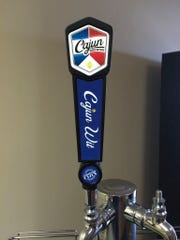 The folks at Cajun Brewing make their own tap handles at the brewery.