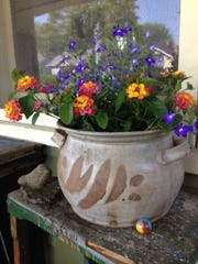 The marble at the base of this pot was found deep in a front flowerbed earlier this spring.