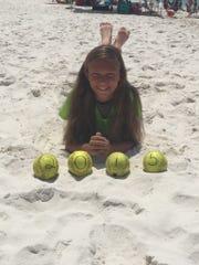 Kate Bruggenschmidt, 11, was riding an ATV with a softball