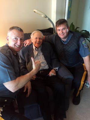 South Nyack-Grand View Police Det. James Coyle, left, with sportscasting legend and South Nyack resident Bob Wolff, center,  and South Nyack-Grand View Police Officer Patrick Gallagher. Wolff expressed gratitude for the Rockland community after first-responders assisted him and his wife.