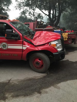 Firefighters were not injured after a boulder fell on a patrol vehicle.