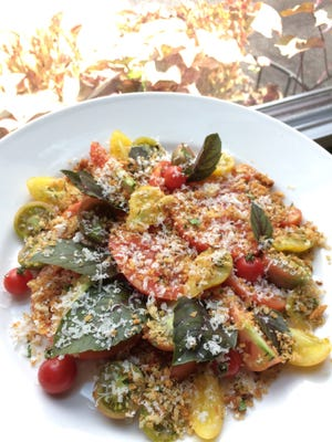 A fresh heirloom tomato salad with garlic breadcrumbs, Parmesan and opal basil is a showcase of summer bounty at Margot Cafe and Bar in East Nashville.
