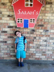 Dylan smiles before his first day at Sarah's DayCare & Preschool in Lafayette.