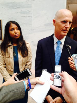 Florida Gov. Rick Scott meets with reporters on Capitol Hill Tuesday along with Florida Surgeon General Celeste Philip in between lobbying lawmakers to pass a Z†ika bill.