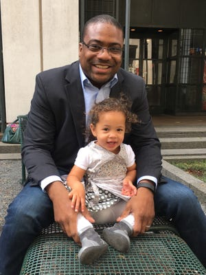 Randy Kinder, here with daughter Fiona, 2, is married to an MSU alum and lives in Washington, D.C. The 41-year-old former East Lansing star and Notre Dame running back works for AFL-CIO.