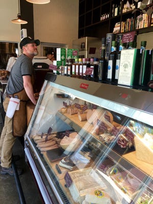 Jay Denham, partner at Red Hog, looks over the counter.