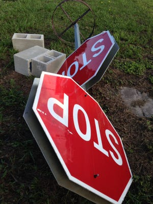 The four-way stop signs are being taken down in Vero Beach.