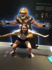 Lia Haile poses with a photo of Clay Matthews.