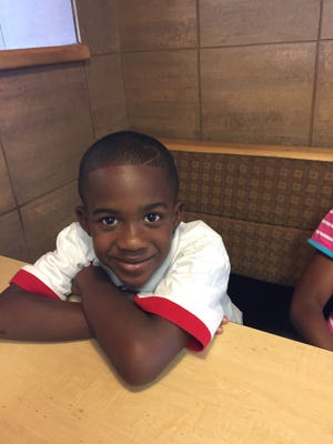 Phillip Neal III, a third-grader at Engelhard Elementary, was struck by a motorist as he was about to board his bus to school.