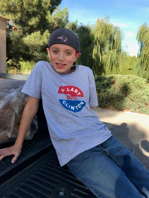 Chris Walker, 10, is a fifth-grade student at Mesilla Elementary. He was recently told he should not wear his Hillary Clinton T-Shirt (pictured) to school after some students' conversations about the presidential campaign turned ugly.