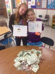 A student challenge by Fox Valley Christian Academy fifth-grade student Lexi George (left), has led to over $1,288 raised for Haiti relief efforts. She pledged to bake cupcakes for the class who raised the most, and her fellow fifth-grade class won. Also pictured is third-grade student Olivia George.
