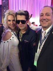 Monique and Tim Breaux are pictured with Milo, a Trump activist.