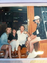 On the back deck of the Gypsy in 1990 looking into the salon, from left to right are Kim Syrus, Judy DiPietro (still behind the bar at Pelican Bend), Eddie Caster and Danny Duffy, Captain of the Island Gypsy.