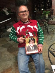 Chad Hauser poses in ugly Christmas Sweater during