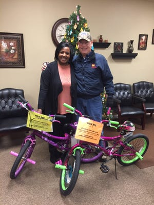 WIN WIN WIN: UMWA Retirees Local 1740 is providing the opportunity to K - 5 students at Uniontown Elementary School to win a bicycle for Perfect Attendance.  Drawing will be held in May 2017 at Honors Day.  Accepting the two bicycles on display is Principal of Uniontown Elementary, Tamala Howard,  from UMWA Retiree Local 1740 member Bill Butler.