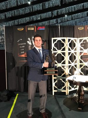 St. John's senior linebacker Carter Hanson poses with the Gagliardi Trophy after winning the award in a ceremony Wednesday night in Salem, Va.