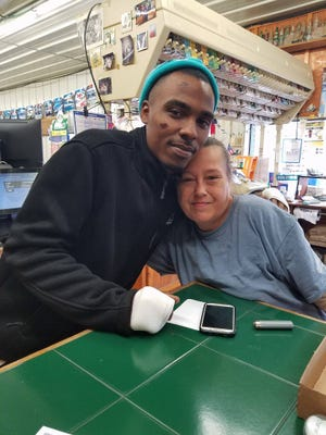 Michael Eugene Johnson Jr. takes a picture with Laurie Paris, the woman who found him lying on Newfound Road after he was attacked December 12, 2016. Johnson was beaten up while he was running. The Buncombe County Sheriff's Office was continuing their investigation Saturday December 17, 2016.