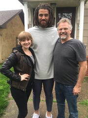 "Lebanon native and professional football player Jared Odrick (center) poses for a picture with Sarah Hawkins (left) and Bradley Hawkins (right) on the set of the movie ""Filling In."""