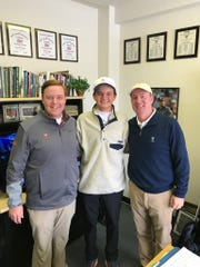 Seacrest golfer David Morgan, center, poses with University of Virginia assistant coach John Phillips (left) and head coach Bowen Sargent after committing to play for the Cavaliers on Monday, Jan. 9, 2017.