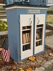 Christina Taylor's little library in Oaklyn is actually her second, built sturdier after the first blew over in a storm.
