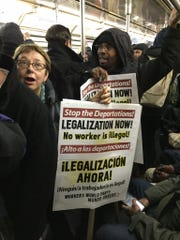 Protesters on the subway in New York en route to John F. Kennedy International Airport on Saturday.