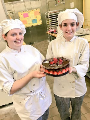 Anna Metz (left) and Samantha Tartaglia — both senior culinary arts students at Gloucester County Institute of Technology — showed the Courier-Post how to make a Valentine's Day-inspired chocolate-strawberry cake.